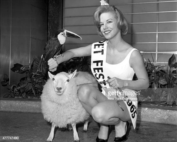 Sunny Austin is joined by a lamb toucan and baby chick after she was named Queen of the Pet Festival at the Coliseum