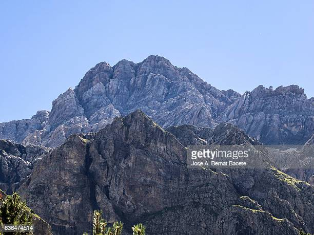 Sunny beaks of big mountains of rock, with a blue sky.  Pyrenees, Spain
