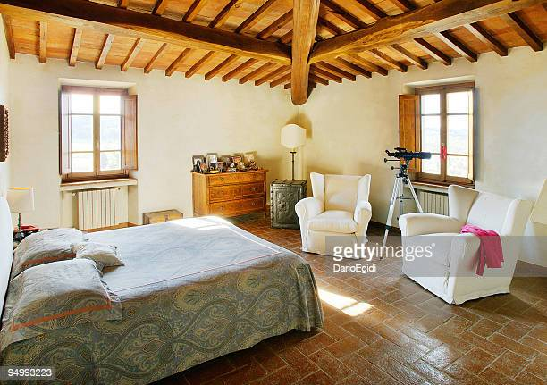 Sunny bed-room with raftered ceiling in a beautiful rustical house