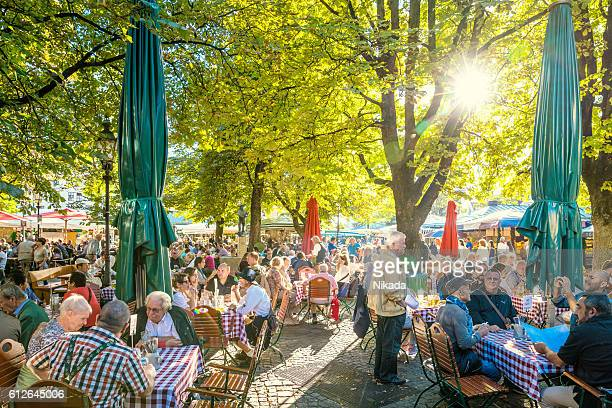 sunny beer garden in munich, bavaria, germany - viktualienmarkt stock pictures, royalty-free photos & images