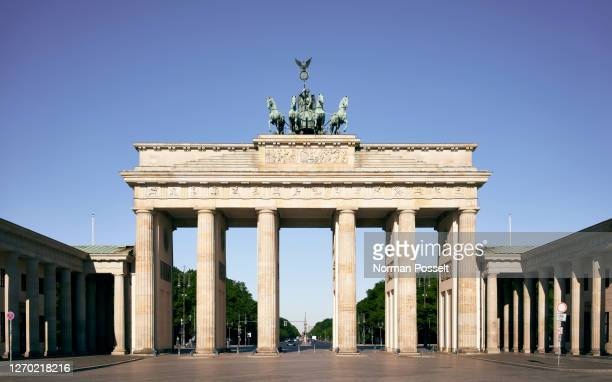 sunny brandenburg gate, berlin, germany - city gate stock pictures, royalty-free photos & images