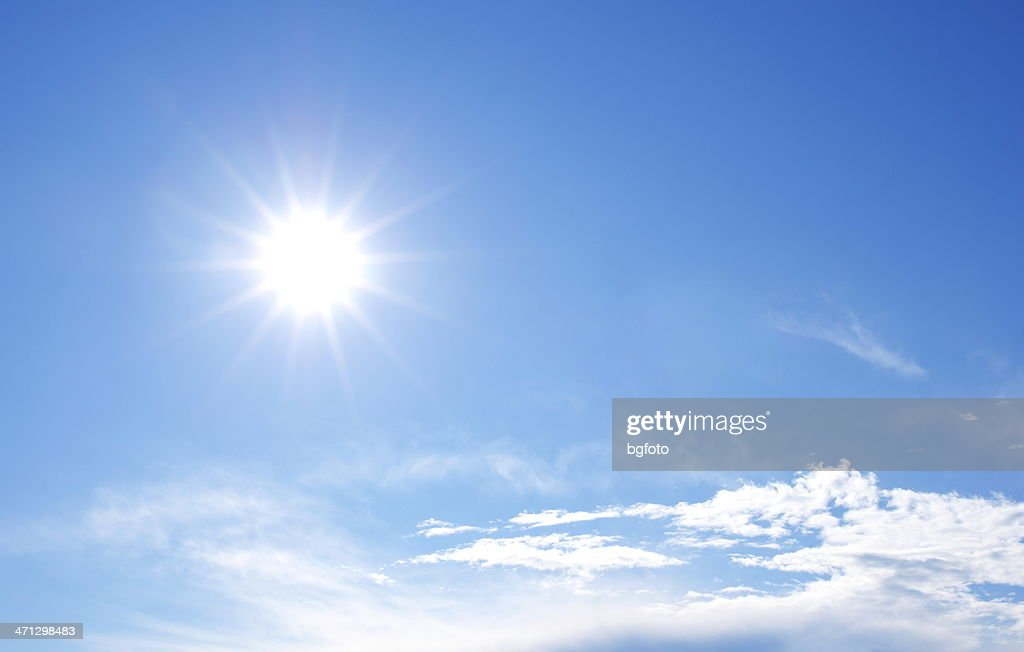Sunny bright blue sky with clouds : Stock Photo