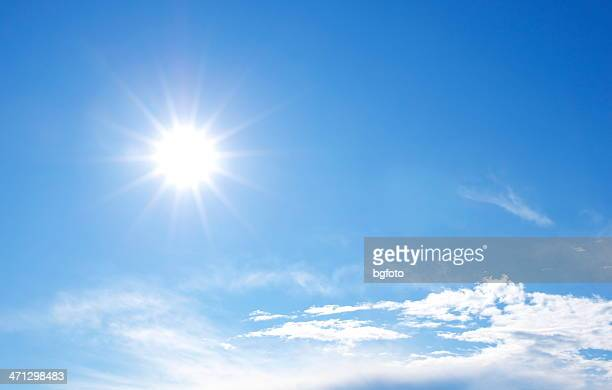 sunny bright blue sky with clouds - suns stock photos and pictures