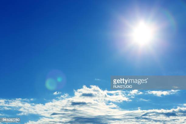 sunny bright blue sky with clouds - sonnenlicht stock-fotos und bilder