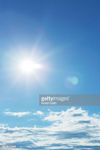 sunny bright blue sky with clouds - wolkenloser himmel stock-fotos und bilder