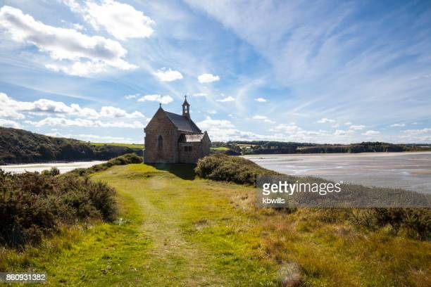 sunny chapel of st maurice overlooking the anse de morieux - cotes d'armor stock photos and pictures