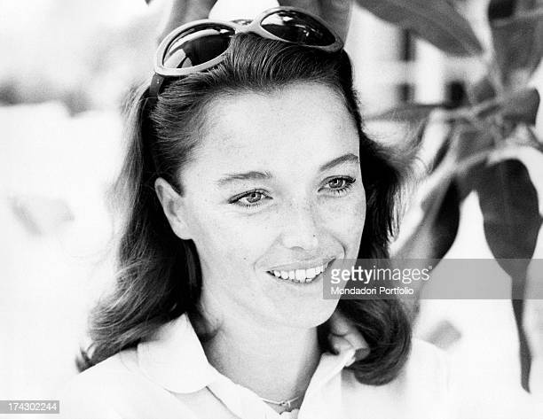 Sunny closeup of Italian announcer and presenter Aba Cercato with the hair held by sunglasses Venice 1974
