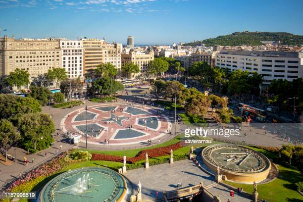 sunny day in plaça de catalunya, barcelona, spain - catalonia stock pictures, royalty-free photos & images