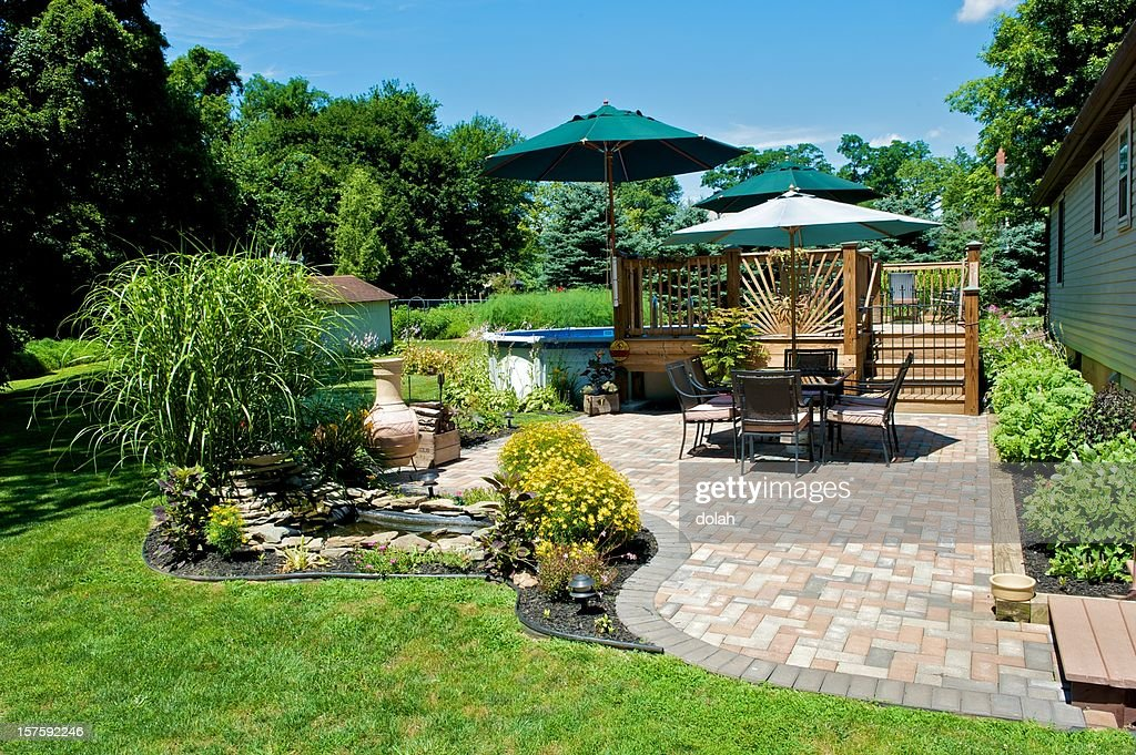 Sunny day on a terrace with table and sun umbrella : Stock Photo