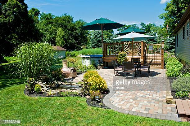 sunny day on a terrace with table and sun umbrella - landscaped stock pictures, royalty-free photos & images