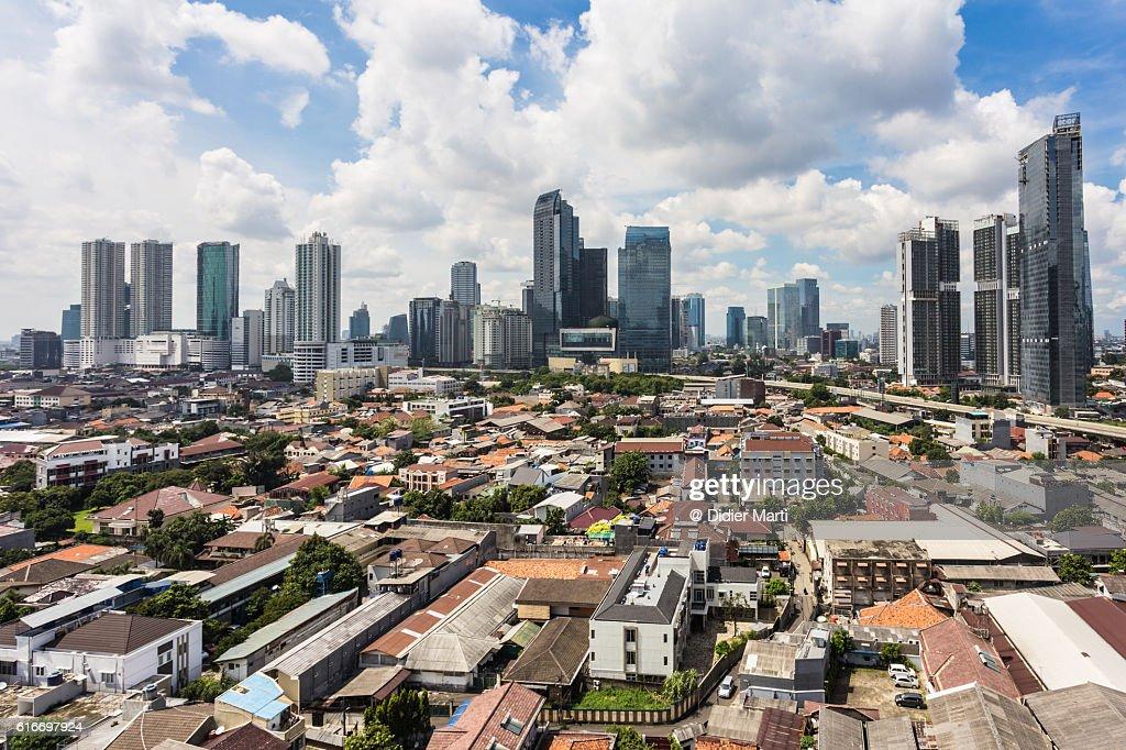 Sunny day over Jakarta modern skyline : Stock Photo