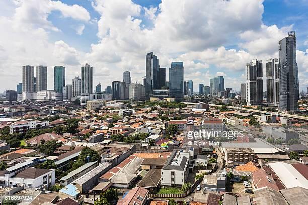 Sunny day over Jakarta modern skyline