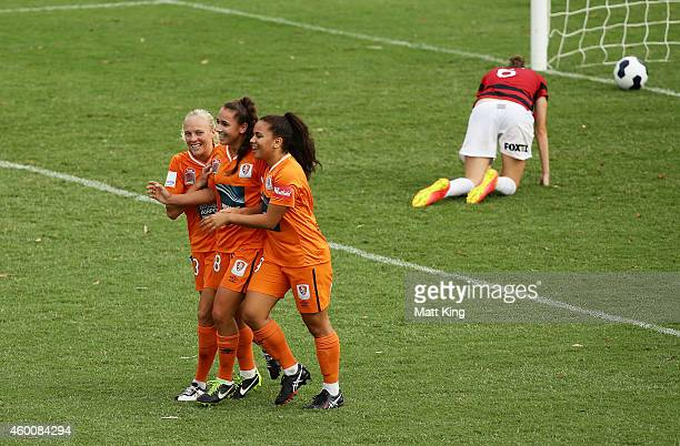 Sunny Franco of the Roar celebrates with team mates after scoring a goal during the round 12 WLeague match between Western Sydney Wanderers and...