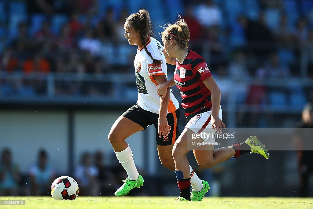 Sunny Franco of the Roar takes on Georgia Plessas of the Wanderers during the round four W-League match between the Western Sydney Wanderers and the Brisbane Roar at Marconi Stadium on November 26, 2016 in Sydney, Australia.