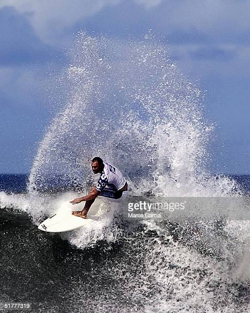Sunny Garcia surfs a wave in the finals of the Vans Triple Crown of Surfing November 22 2004 at Ali'i Beach Park in Haleiwa Hawaii Garcia went on to...
