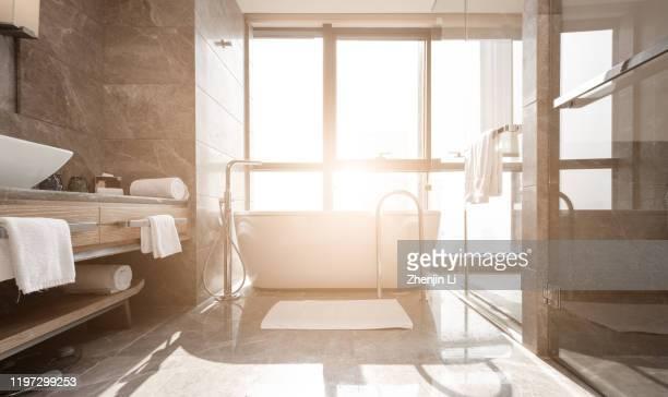sunny indoor bath tub / chongqing, china - sonnig stock-fotos und bilder