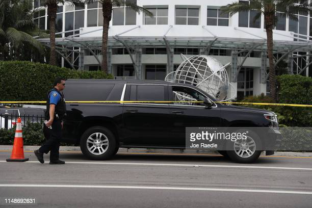 Sunny Isles Beach police officer works near the black Suburban SUV that reports say is the vehicle rapper NBA Youngboy was riding in when a shooting...