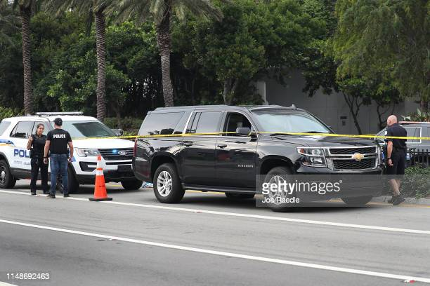 Sunny Isles Beach police officers work near the black Suburban SUV that reports say is the vehicle rapper NBA Youngboy was riding in when a shooting...