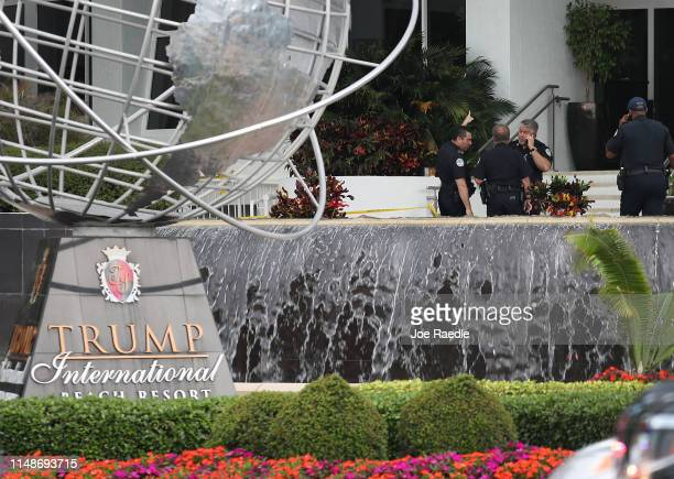 Sunny Isles Beach police officers work near the entrance to the Trump International Beach Resort as they investigate a shooting that reports say...