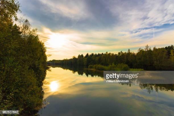 sunny lake - william mevissen stockfoto's en -beelden