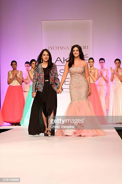 Sunny Leone walks the runway with Jyotsna Tiwari at Lakme Fashion Week Summer/Resort 2014 at the Grand Hyatt on March 16 2014 in Mumbai India