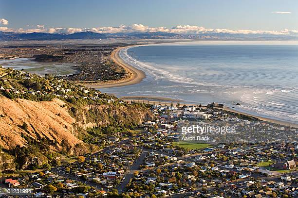 sunny morning at beach town near river mouth - christchurch new zealand stock pictures, royalty-free photos & images