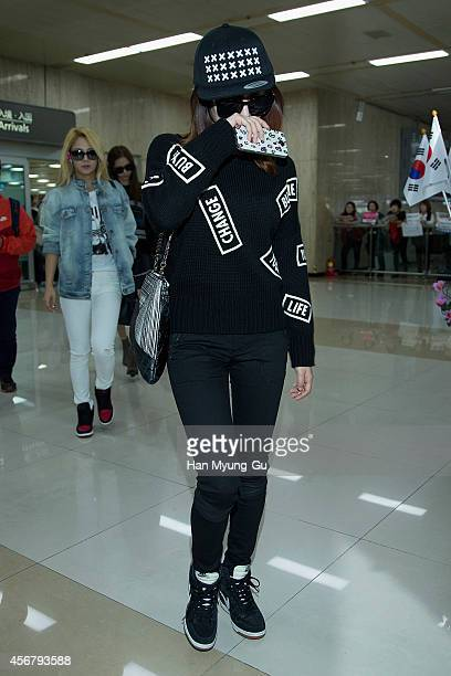 Sunny of South Korean girl group Girls' Generation is seen upon arrival at Gimpo International Airport on October 7, 2014 in Seoul, South Korea.