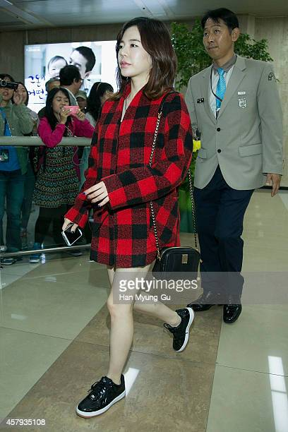 Sunny of South Korean girl group Girls' Generation is seen upon arrival at Gimpo International Airport on October 26, 2014 in Seoul, South Korea.