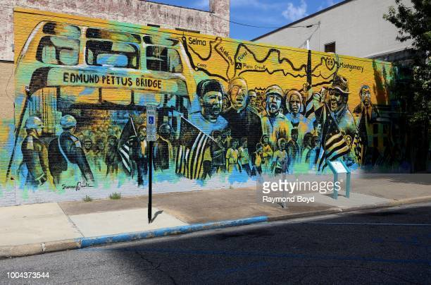 Sunny Paulk and Corey Spearman's 'A Mighty Walk From Selma' mural which depicts the 54mile march from Selma's Edmund Pettus Bridge to the Montgomery...