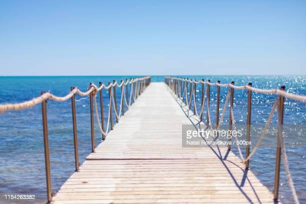 sunny pier - djerba stockfoto's en -beelden