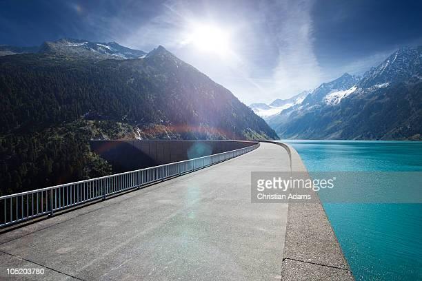 Sunny road across dam