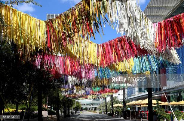Sunny Sliger and Marianne Newsom of The Color Condition 'Arcade ' art installation consists of strips of tablecloths shower curtains and painters...