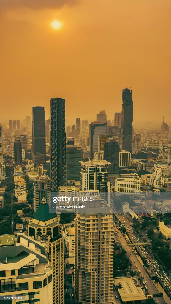 Sunny, smoggy afternooon in Bangkok : Stock Photo