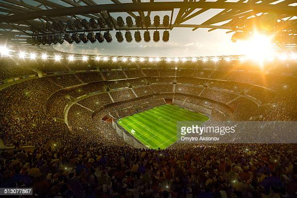 sunny soccer stadium - football stadium stock photos and pictures