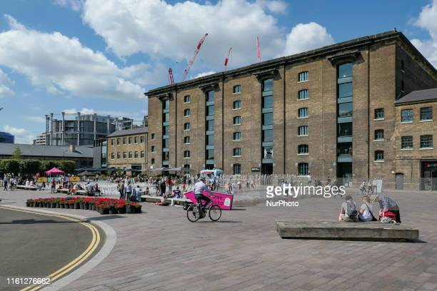 A sunny summer day with high temperatures during a heatwave in London UK on August 1 2019 People including adults and children playing with the water...