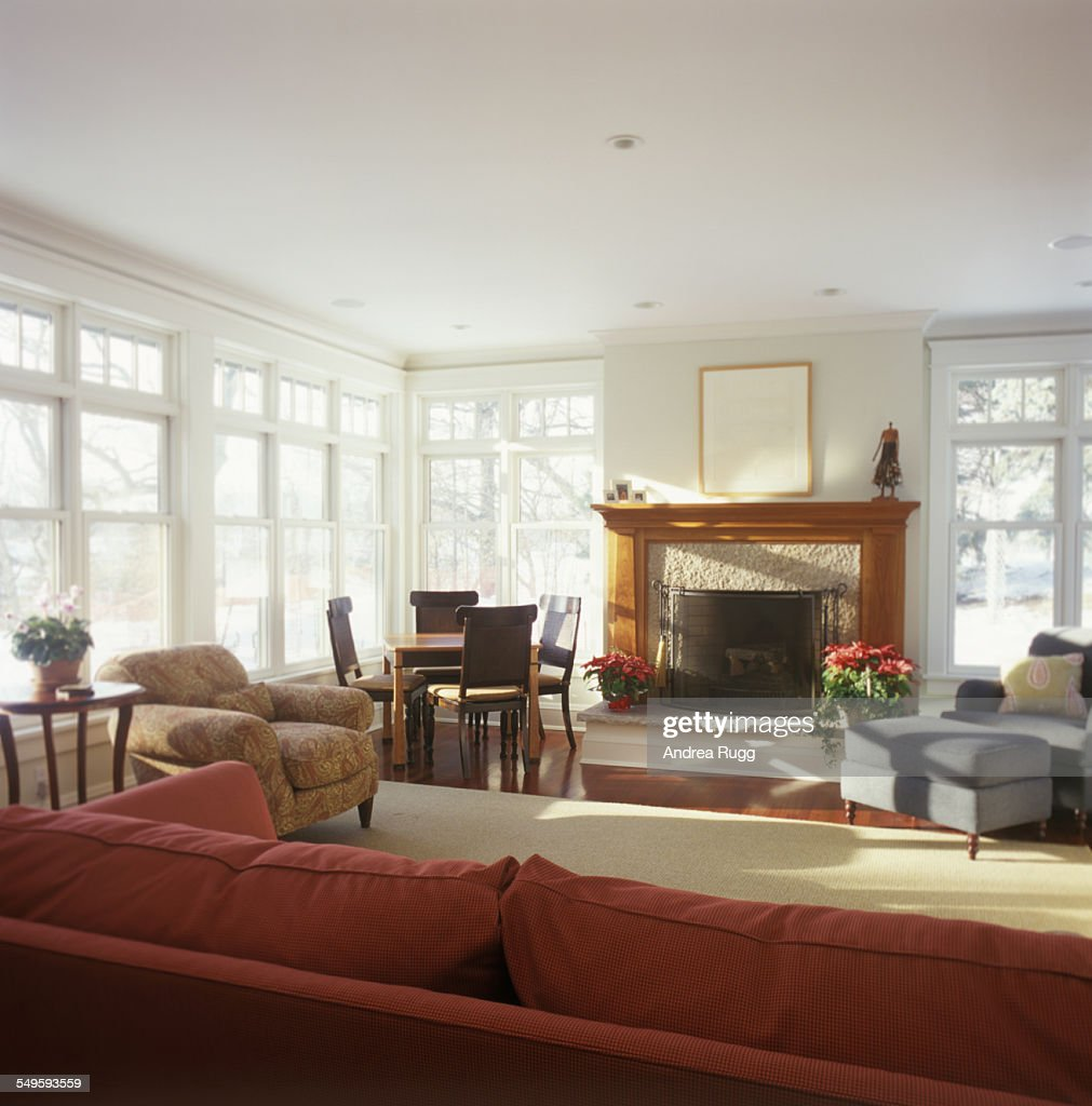 Sunny Traditional Living Room With Fireplace High Res Stock