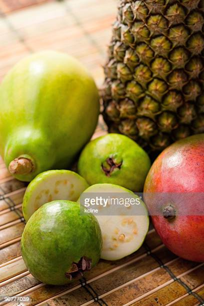 sunny tropical fruits - guava fruit stock photos and pictures