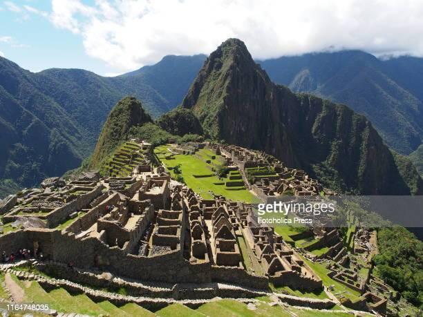 Sunny view of Machu Picchu, a 15th-century Inca citadel located in the Cusco Region, Urubamba Province, Machupicchu District, Peru.
