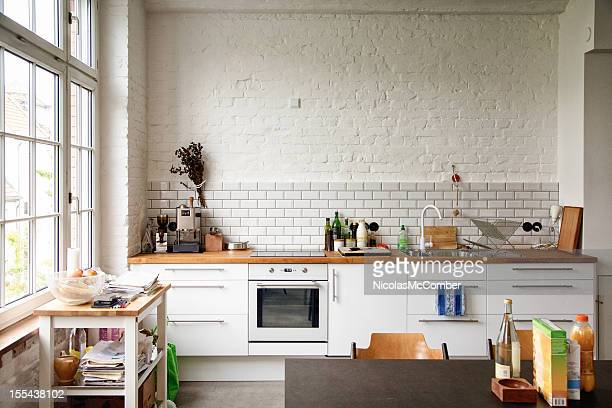 sunny white european kitchen - keuken stockfoto's en -beelden