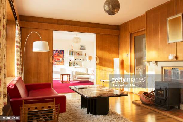 Sunny wood paneled living room