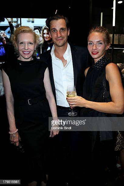 Sunnyi Melles Max von Thun Hohenstein and Kim Eberle attend the Karl Lagerfeld store opening on September 4 2013 in Munich Germany