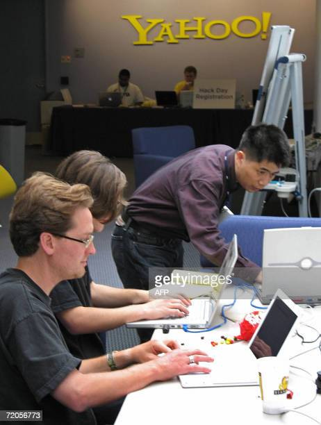 TO GO WITH 'AFPLifestyleITInternethackermusicYahoo' Matt Olson Kristopher Tate and Qingfeng Huang work through the night manipulating computer code...