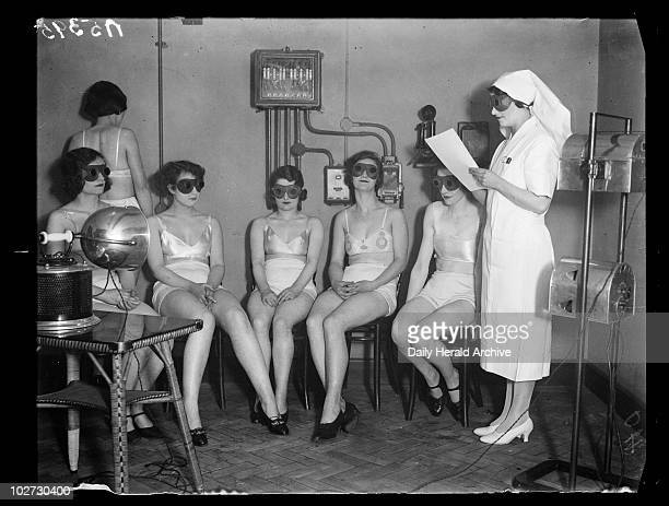 Sunray 'treatment' 1932 A photograph of women receiving sunray 'treatment' taken by Cardew for the Daily Herald newspaper on 20 February 1932 These...