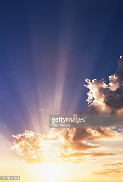 Sunrays in a Bright Cloudy Sky