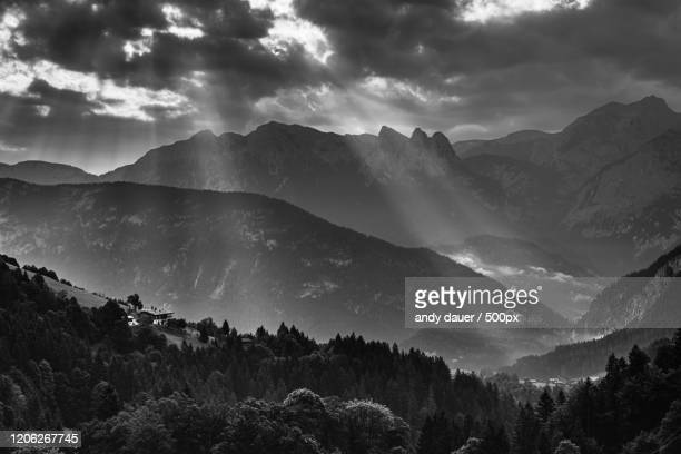 sunrays over high mountains - andy dauer stock pictures, royalty-free photos & images
