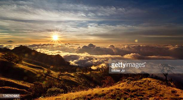 Sunrise above clouds from Mount Rinjani