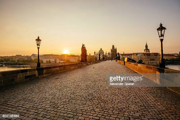 sunrise above prague seen at charles bridge, czech republic - charles bridge stock photos and pictures