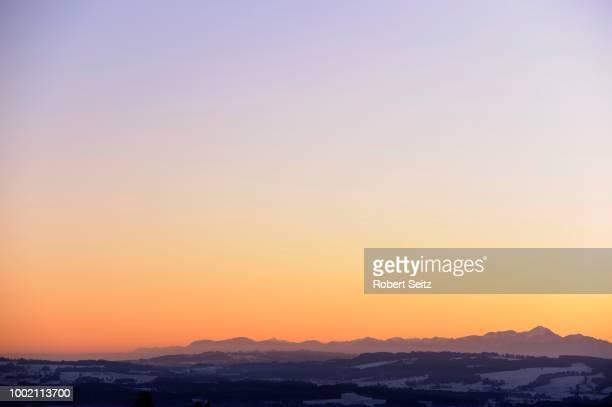 sunrise above the alps, auerberg, markt oberdorf, allgaeu, bavaria, germany - look back at early colour photography imagens e fotografias de stock