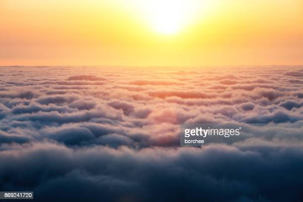 sunrise above the clouds - sopra foto e immagini stock