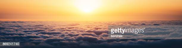 sunrise above the clouds - panoramic stock pictures, royalty-free photos & images